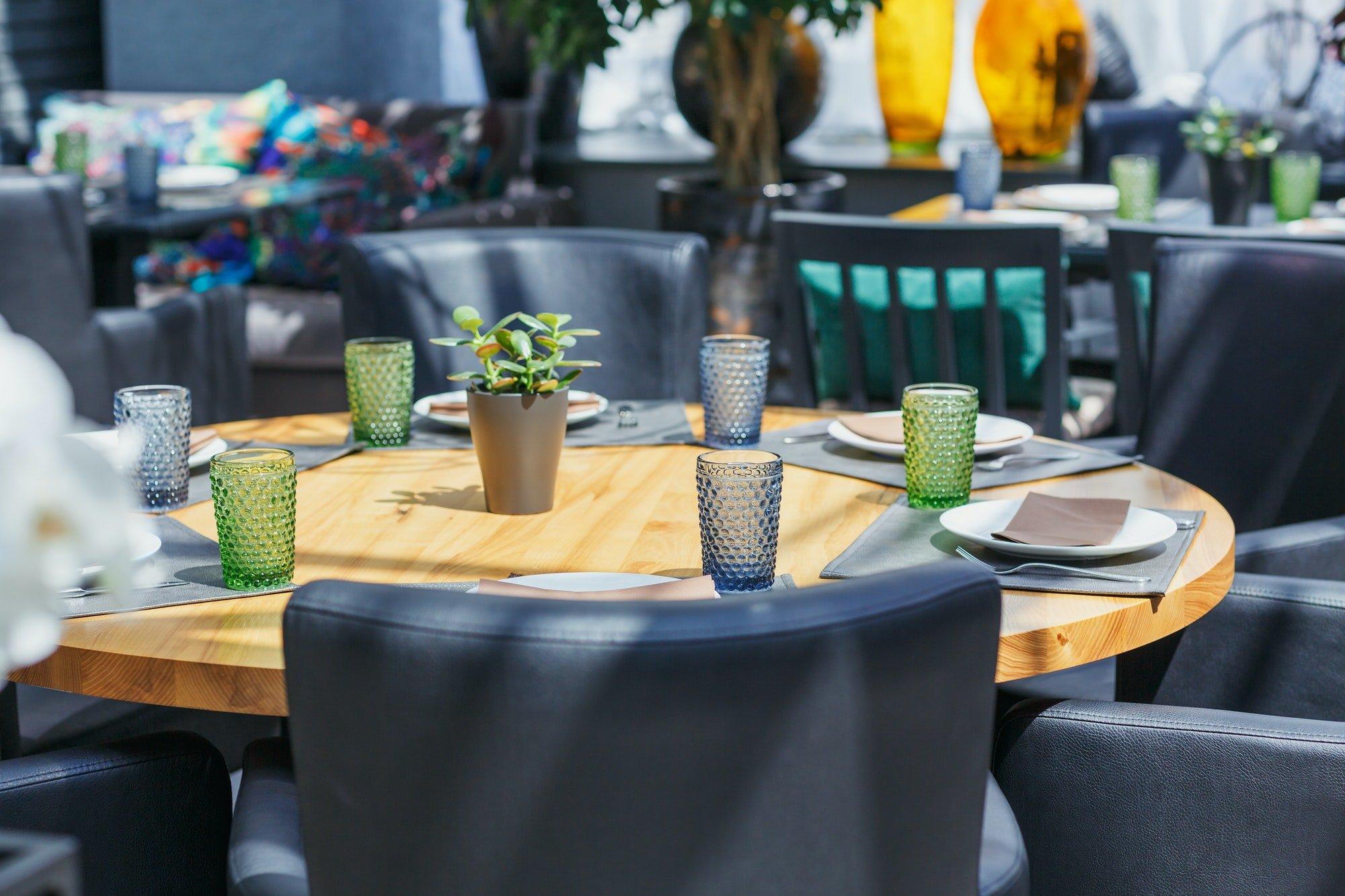 Table arrangement in restaurant. Event design